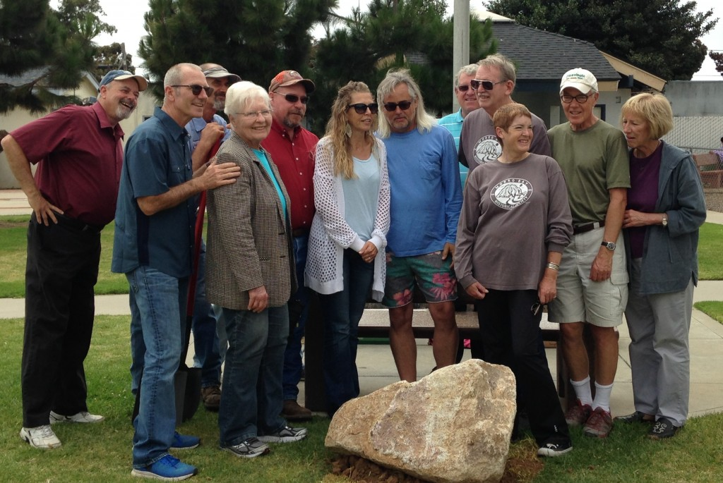 City of Morro Bay Mayor, Jamie Irons (in blue shirt on left), poses with members of the Historical Society of Morro Bay and the Morro Bay 50th Celebration Committee at the time capsule site. A plaque commemorating the event will be installed on the large rock that sits over the capsule.