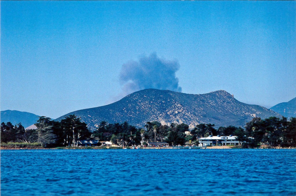 The smoke plume from the Highway 41 fire in August of 1994 begins. Photograph taken by Ruth Ann Angus from a kayak in the Morro Bay estuary.