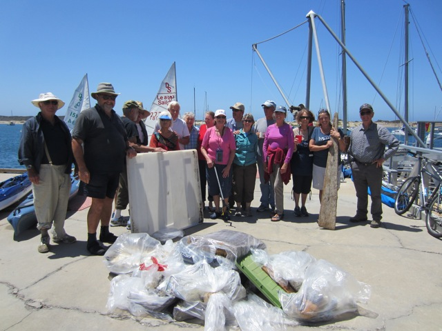 The Morro Bay Yacht Club Fun Floaters display the trash they collected during their sandspit cleanup in August.