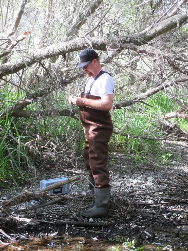 Charles Payton, Monitoring Volunteer of the Year, monitors water quality at a local creek.