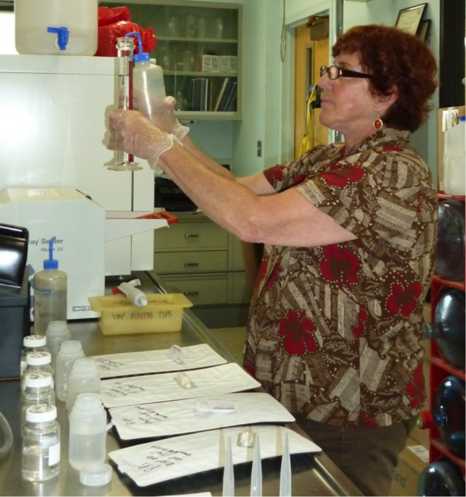 Estuary Program volunteers collect bacteria samples using sterile techniques. Volunteers then analyze the samples to quantify the bacteria concentrations using the IDEXX method.