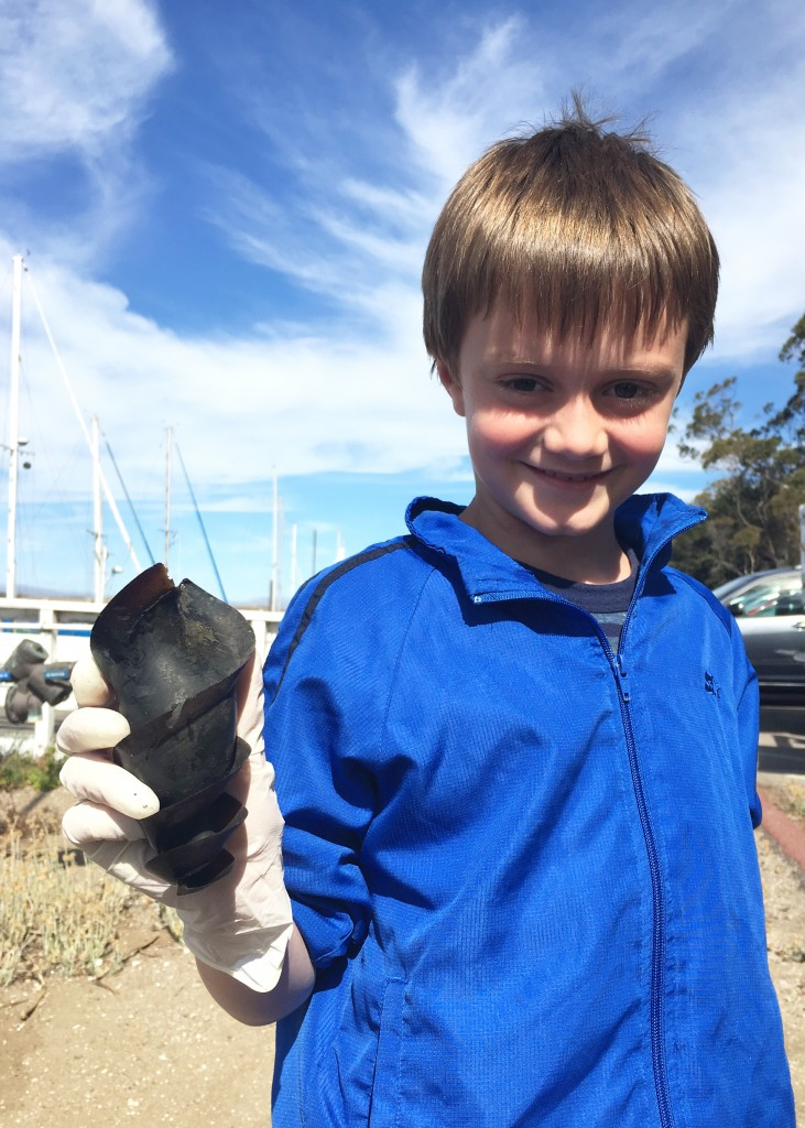 Volunteer River Ciao Flynn holds the horn shark egg case he found during our shoreline cleanup.
