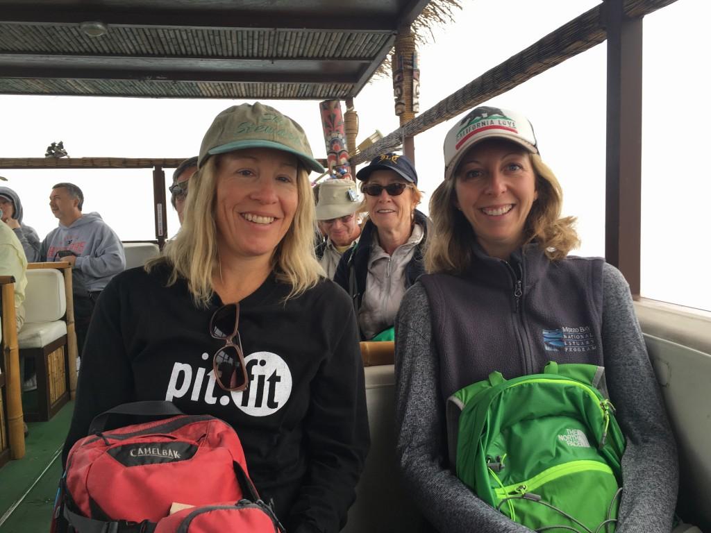 Volunteers Katie and Kathryn enjoy the misty ride.