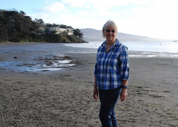 Karen stands at Windy Cove.