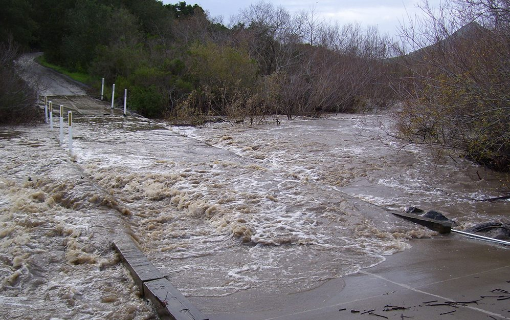 In this photograph from 2019, heavy rains caused Chorro Creek to top the bridge at Canet Road. With climate change, we expect that the Morro Bay area will receive less overall precipitation and that the storms we do experience will be more intense.