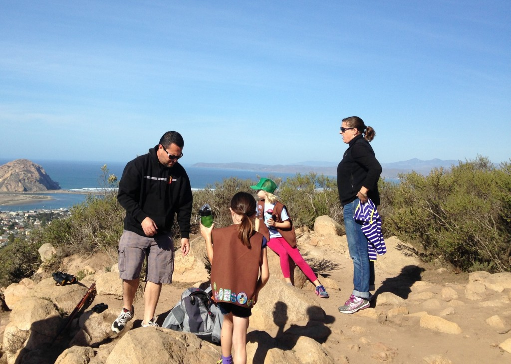 A group of girl scouts and their parents look out over the estuary from the top of Black Hill.