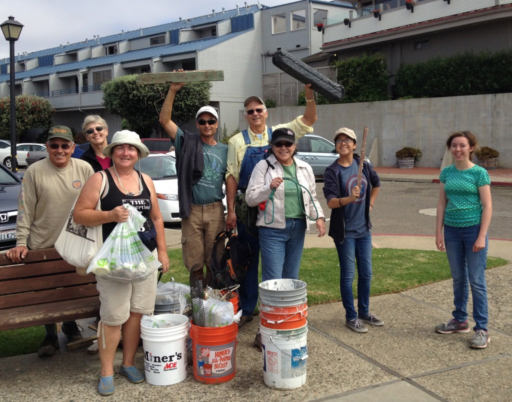 Volunteers celebrate their haul after Coastal Cleanup Day 2014