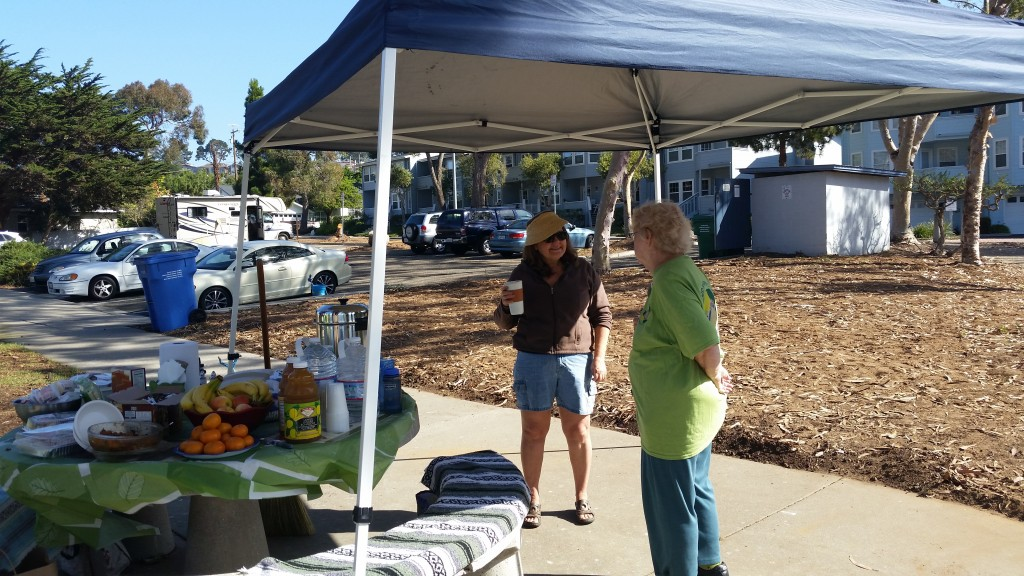 Eco Rotary Club Members Jean (left) and Ruth Ann right) take a moment to visit near the information booth. Photograph courtesy of Mary Hudson.