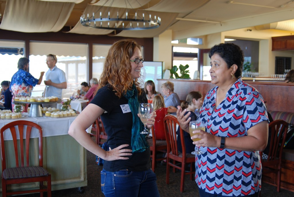The Estuary Program's Executive Director, Adrienne Harris (left), talks with Bay Foundation Board Member, Deanna Richards.