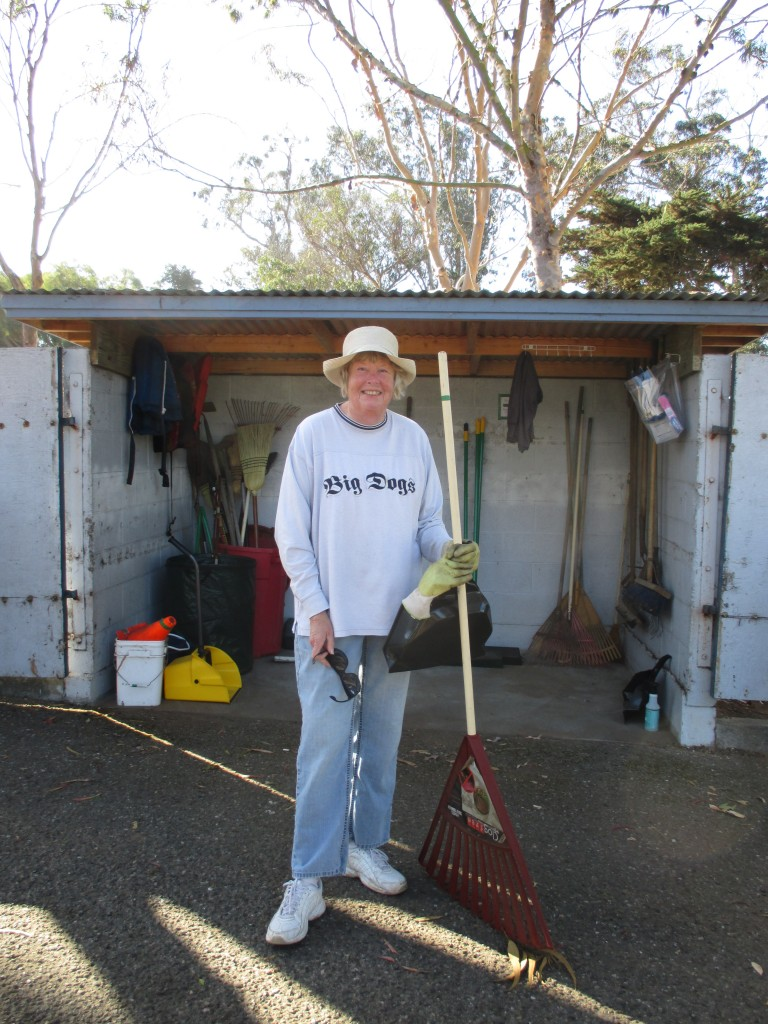 Community volunteer, Doreen, grabs some tools from the shed and gets ready to work.