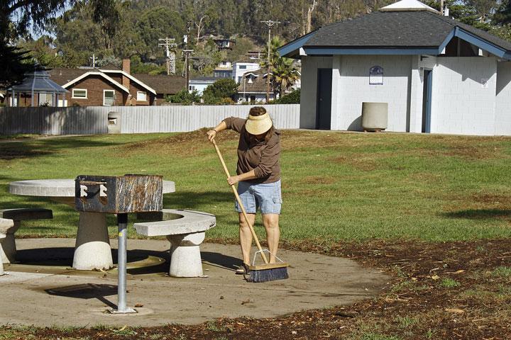Club member Jean sweeps a picnic area clean. Photograph courtesy of Ruth Ann Angus.