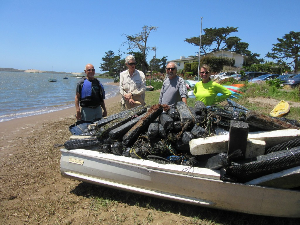 5 volunteers spent 15 total hours skimming, hauling, and pulling trash from the shoreline of the Elfin Forest by boat. They event pulled this skiff out of the water!