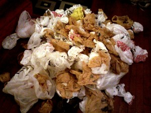 """This photograph, taken by Taber Andrew Bain, shows a pile of """"highly compressed plastic bags"""" that accumulated over a year of trips to the store."""