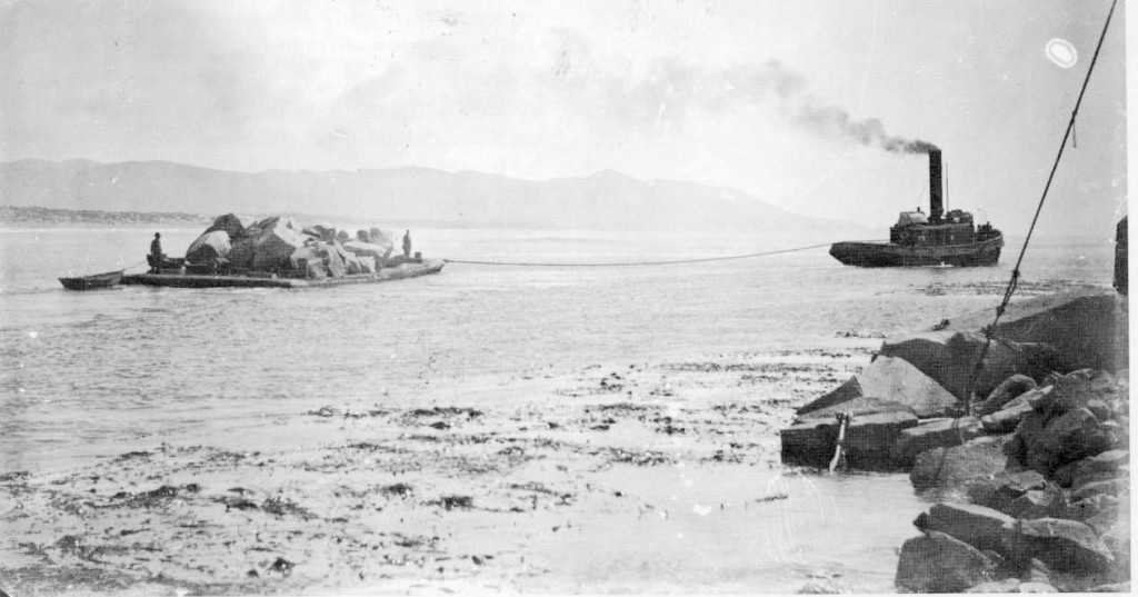 This image from the Estuary Program's archives shows a barge carrying material quarried from Morro Rock. Part of Morro Bay history.