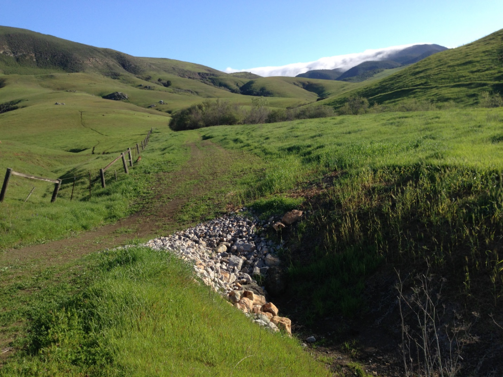 Our rural road restoration project addressed 58 sites on more than 11 miles of road. The road above, located on Camp San Luis Obispo, was eroding and at risk of becoming impassable before this project. We added the large rocks along the side of the road to stabilize it, reduce erosion, and to help slow and direct water off its surface during storms.