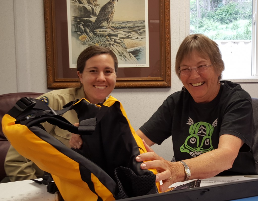 Jenny and Bette, two of the members of the team who created and implemented the SeaLife Stewards program check out one of their new life vests.