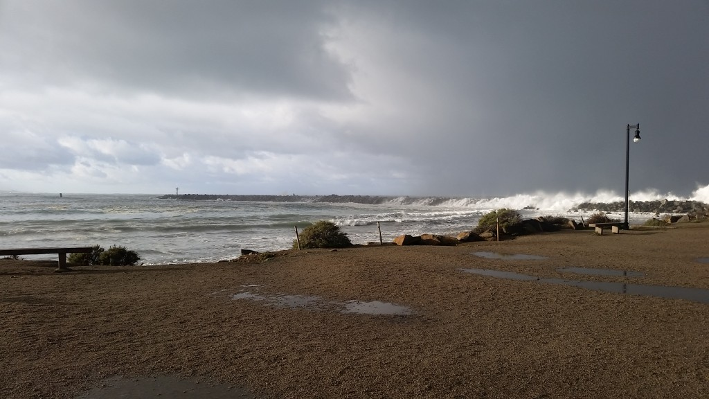 Salty ocean water enters the bay through the harbor mouth. During big storms, like the one pictured above, waves can even wash over the jetty.
