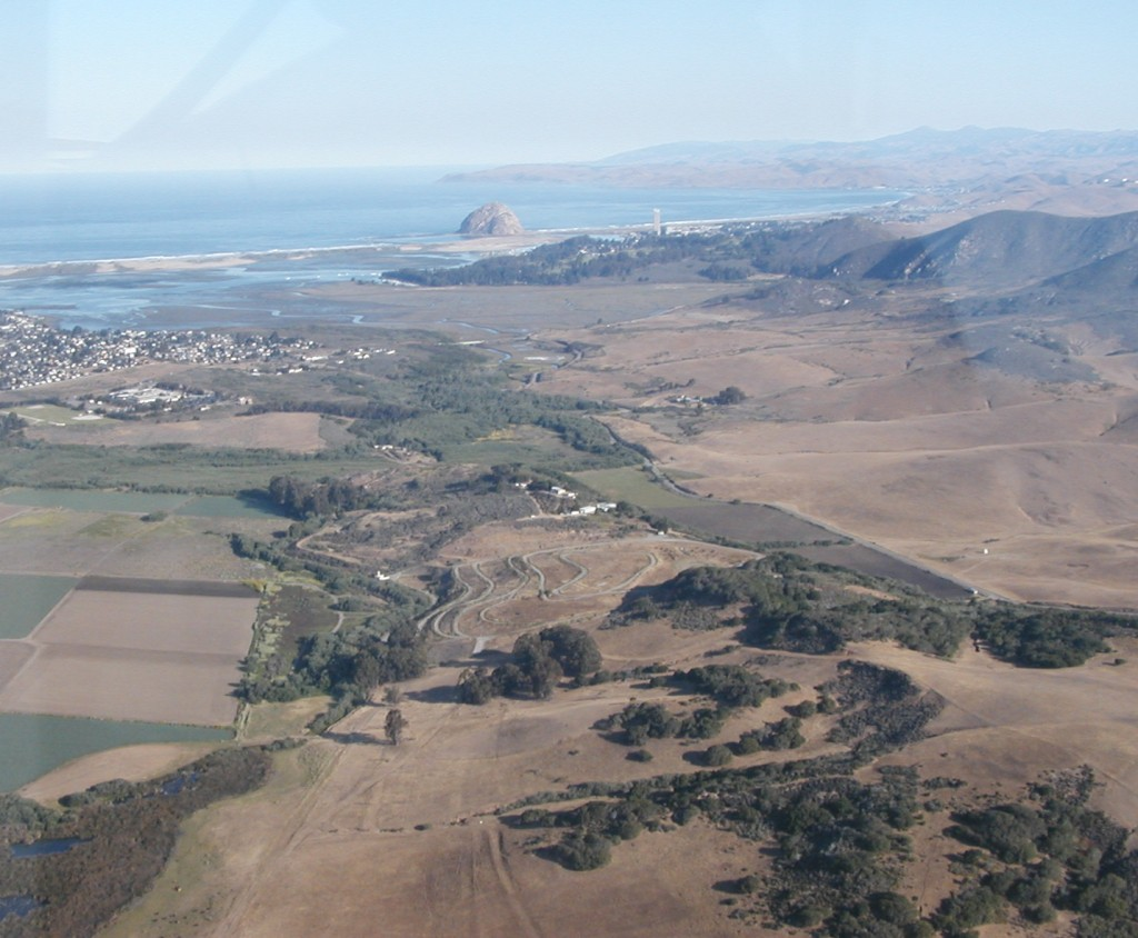 This photograph shows Morro Rock, Morro and Estero Bays, and a portion of the watershed. It was taken from the window of a plane in 1988, seven years before the establishment of the Morro Bay National Estuary Program.