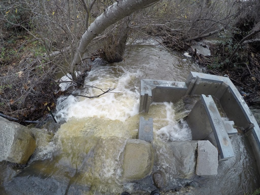 You can see one of our PTDs on the lower left of this photo. This one held up through the high flows of last winter, but you can imagine why surveying them is important!