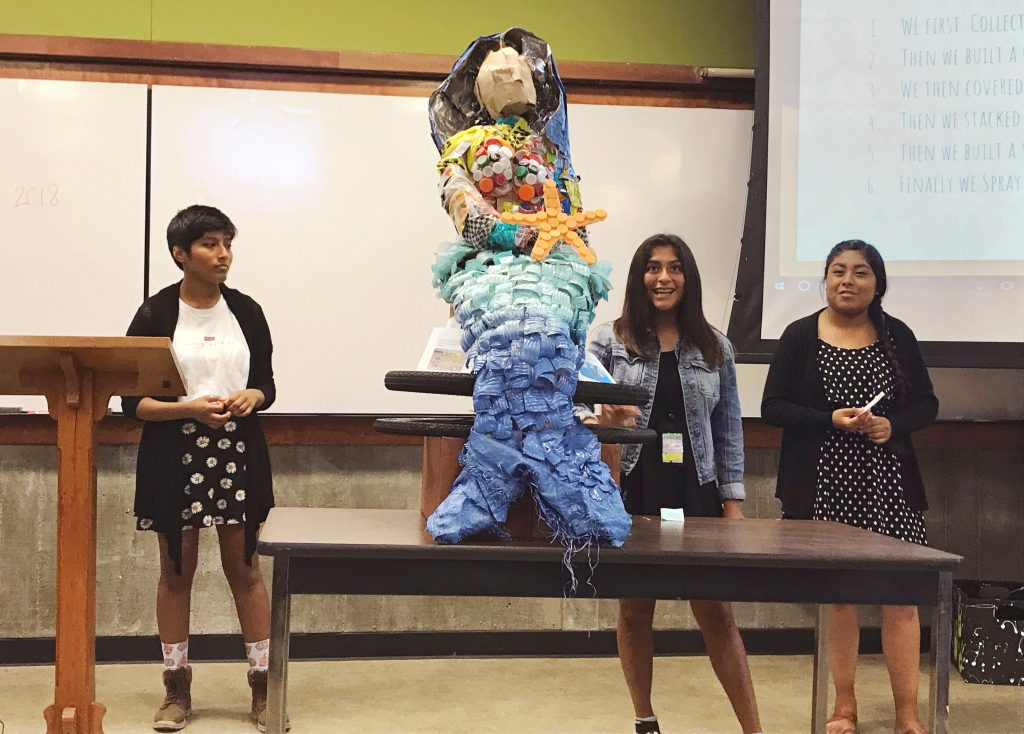 The students who created the mermaid sculpture presented their artwork to the crowd and explained its symbolism as well as the importance of reducing the amount of debris that enters the ocean.