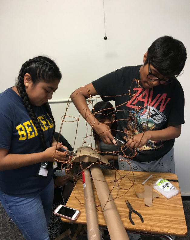 The students created a wire frame in the shape of the mermaid. and then fastened the marine debris to the frame to create the final sculpture.