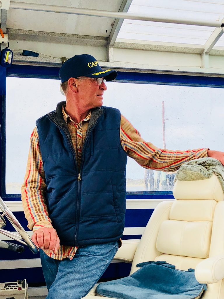 """We are grateful to Captain Stew for donating a ride over to the sandspit for our volunteer crew for the second year in a row. Thanks, Captain Stew! Photo Courtesy of Michael """"Mike"""" L. Baird. bairdphotos.com."""