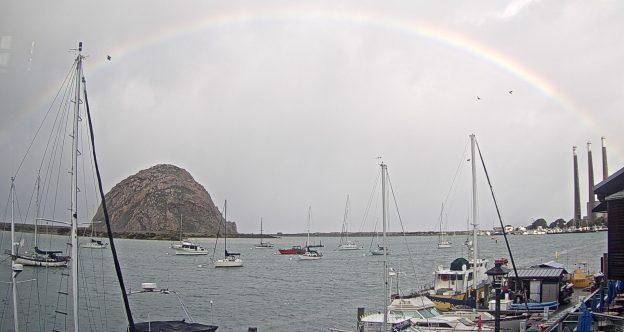 A rainbow arches over Morro Rock on a February morning.