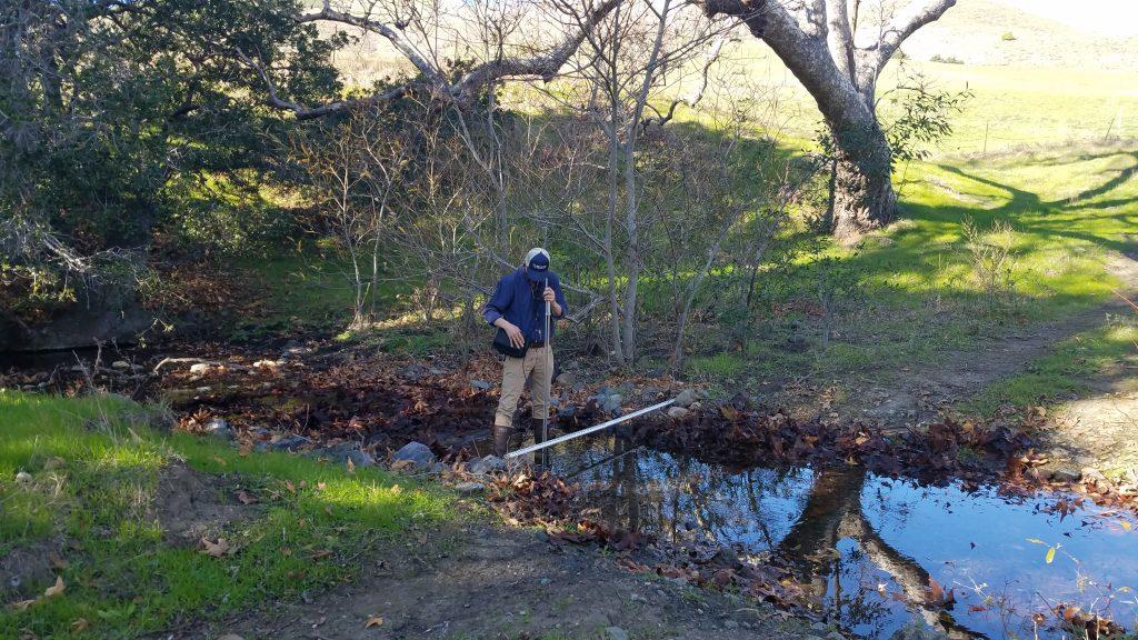 Blake, our monitoring technician, measures streamflow on Pennington Creek.