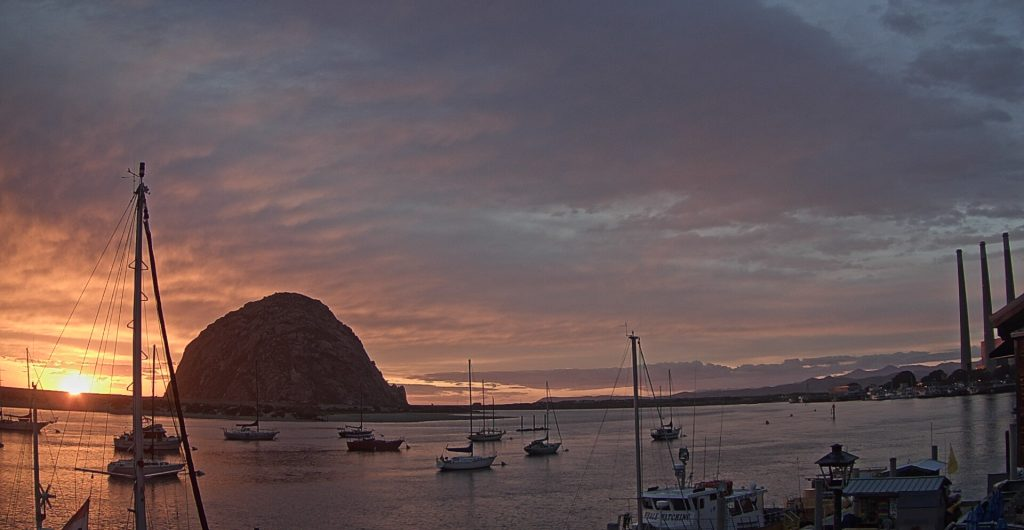 A little later on the same night, the gold, orange, and pink stripes have melded together and the sun is just about to dip behind the sandspit.