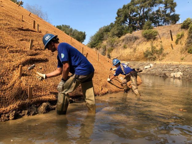 Installation of erosion control fabric to stabilize the left bank of a restoration project in the Santa Rosa Creek Watershed.