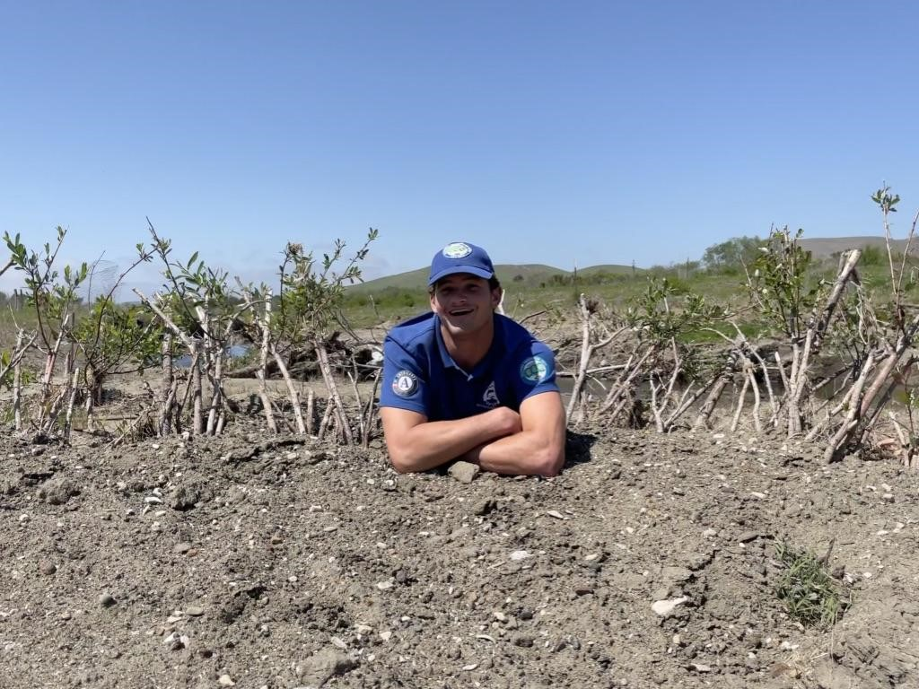 Ryan rests in a willow baffle at the Chorro Creek Ecological Reserve. Willow baffles are structures made of willow cuttings to stop sediment and control erosion in creeks.